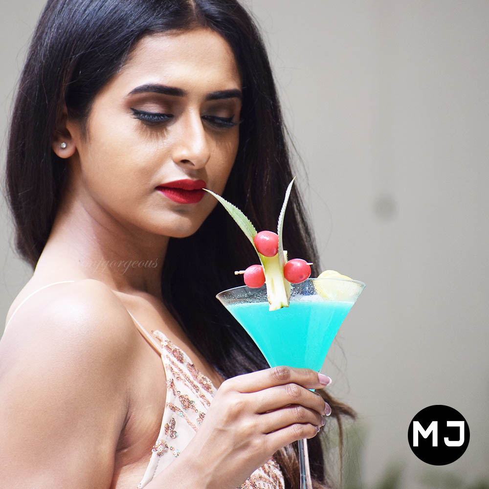 best model posing with a drink